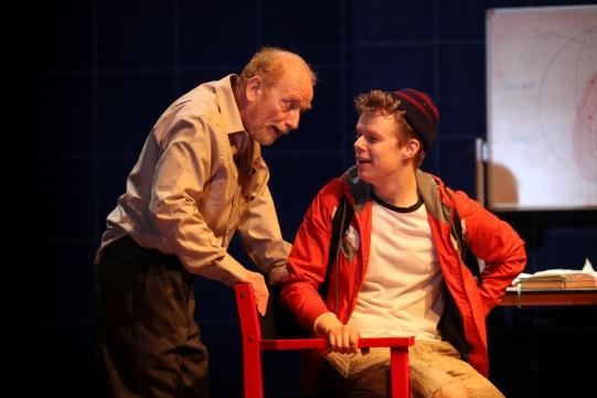 Ian McDiarmid as Galileo talks to Matthew Aubrey as Andrea.