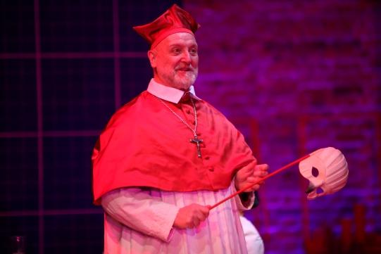 Philip Whitchurch as Cardinal Barberini, holding a white mask.
