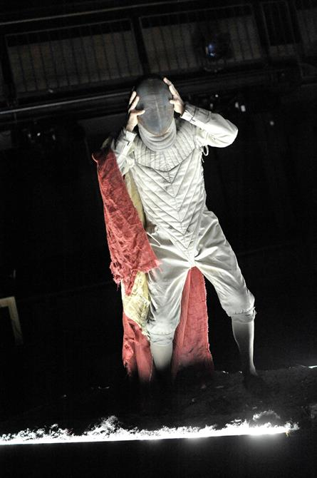 Greg Hicks as the ghost of Hamlet's father, dressed as a fencer in a white fencing mask