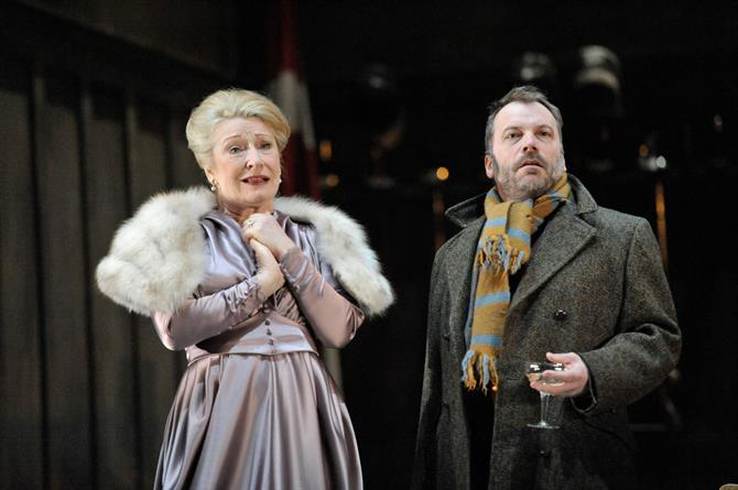 Charlotte Cornwell as Gertrude and Nicolas Tennant as Guildenstern. She is dressed in silk and furs, while he is less formal in a grey coat and stripy scarf.