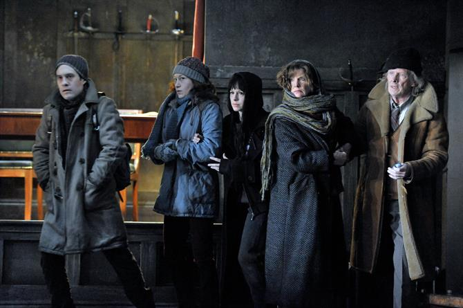The Players in Hamlet wearing scruffy coats and hats