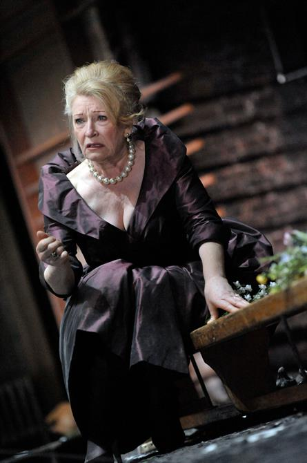 Charlotte Cornwell as Gertrude, in a purple gown with a pearl necklace