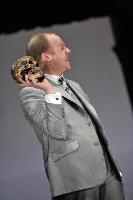 Jonathan Slinger as Hamlet, holding a skull