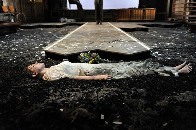 Pippa Nixon as Ophelia in a dirty wedding dress lying dead in the mud