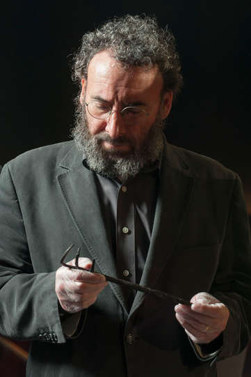 Antony Sher, who plays Falstaff, examines an object from the Museum of London collection 2014