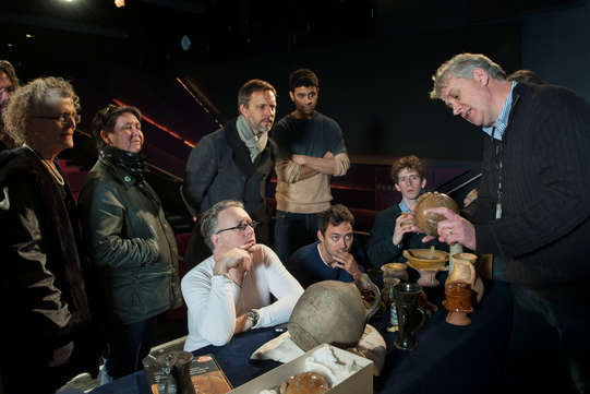 The Henry IV company at the Museum of London looking at London tavern pots