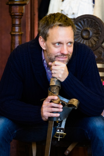 Trevor White as Mowbray rests his head on the hilt of his sword in rehearsal for Henry IV Part II 2014