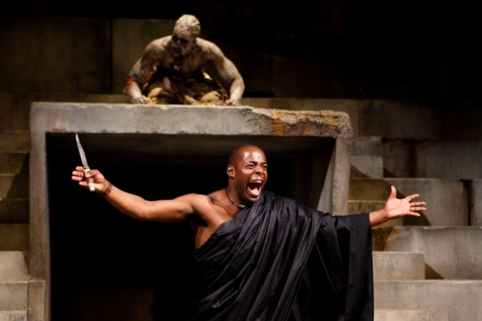 Paterson Joseph holds a knife as Theo Ogundipe looks on.