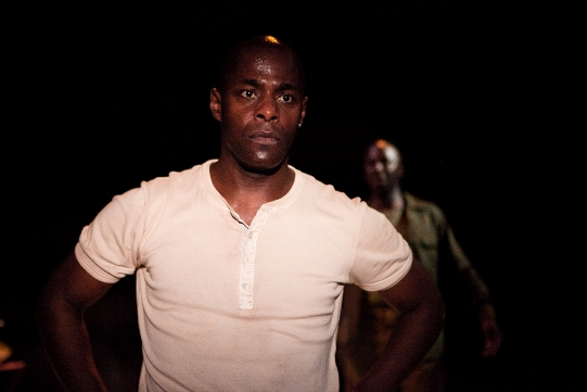 Paterson Joseph in a white t-shirt.