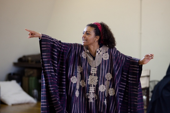 Adjoa Andoh in striped robes during a rehearsal for Julius Caesar.