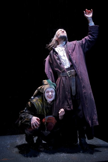 Out on the heath, Lear (Greg Hicks ) roars to the storm, as The Fool (Sophie Russell) crouches at his feet.