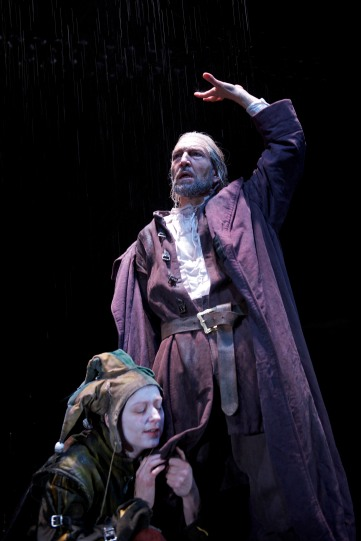 The storm rages on the heath. The Fool (Sophie Russell) tries to persuade Lear (Greg Hicks) to find shelter.
