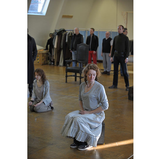 Rehearsing Act 1 Scene 1, where Lear decides how to divide his kingdom between his three daughters.  Kelly Hunter (seated, Goneril) with Samantha Young (kneeling, Cordelia) and John Mackay (standing, Albany).