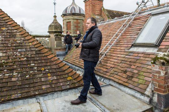 Love's Labour's Lost designer Simon Higlett surveys the roof of Charlecote House in Warwickshire