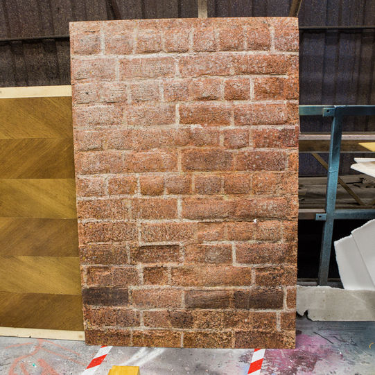 A prop brick wall, part of the set of Love's Labour's Lost 2014