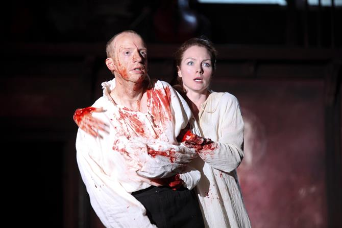 Jonathan Slinger and Aislin McGuckin covered in blood.