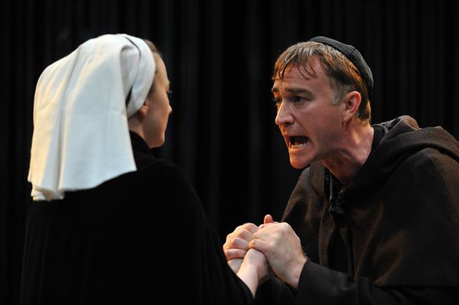Production image of Jodie McNee as Isabella (left) and Raymond Coulthard as Duke Vincentio (right) in Measure for Measure.
