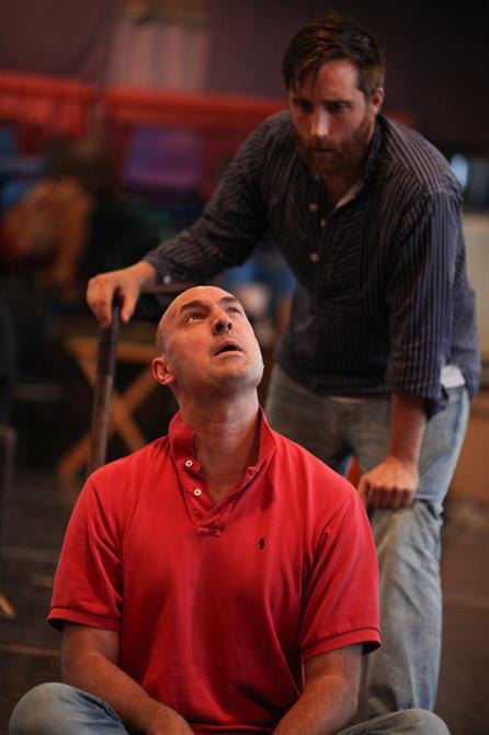 Joseph Kloska standing over a seated Daniel Stewart in rehearsal for Measure for Measure.