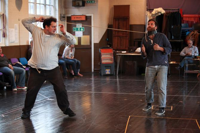 Ian Midlane (left) and Joseph Kloska (right) in rehearsal for Measure for Measure. Ian holding rope and restraining Joseph with a clasp round his neck.
