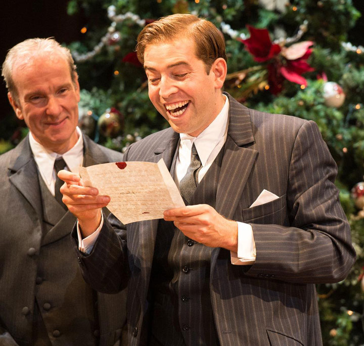 Edward Bennett as Benedick, reading a letter and laughing