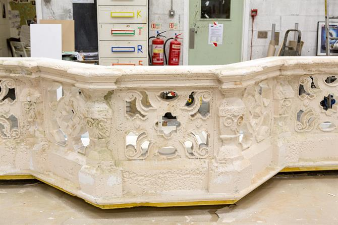 Part of the set being built, showing a stone parapet with intricate designs