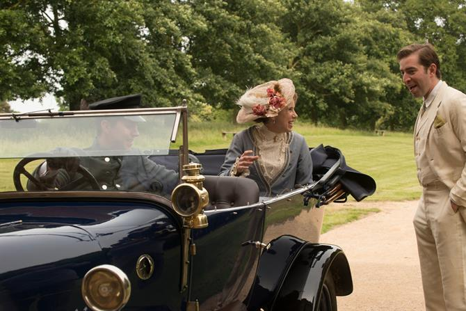 Michelle Terry in a classic car