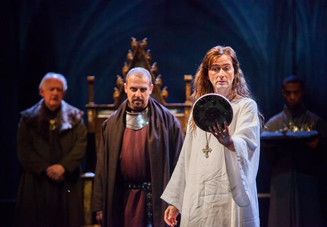 Richard II (David Tennant) appears as a Christ-like figure as he looks at himself in a mirror after his abdication