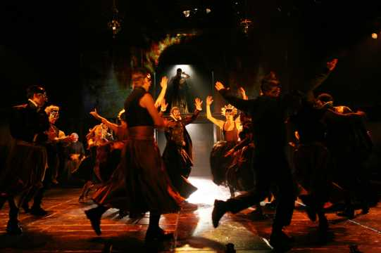 Guests dancing at the Capulet masque ball.
