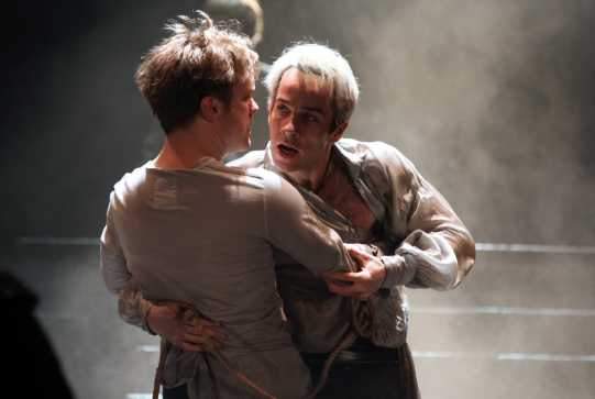 Romeo holds Mercutio in his arms, who is fatally injured.