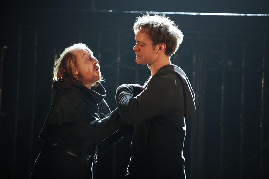 Friar Laurence consoles Romeo.