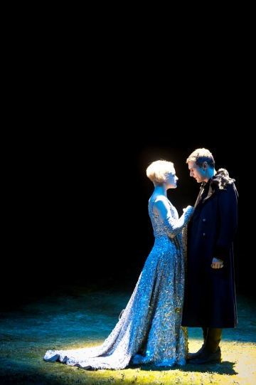 Iris Roberts wears a long blue dress as Marion, with Martin Hutson as Prince John