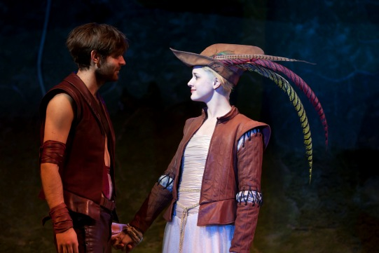 Robin Hood talks to Marion, who wears a cap with long brightly-coloured feathers.
