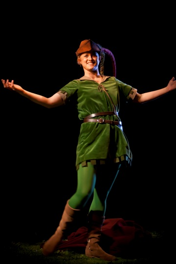 Iris Roberts as Marion in disguise, wearing a green smock, green tights and brown boots