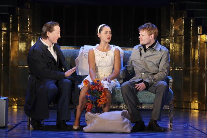 Antonio, Portia and Bassanio sit together at the end of The Merchant of Venice.