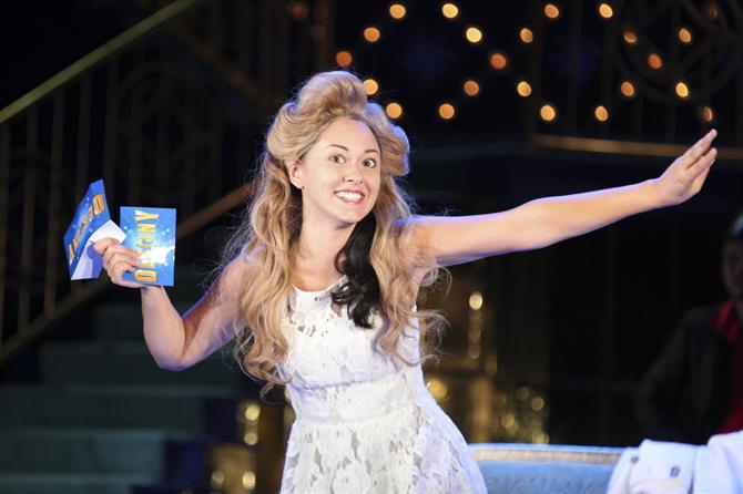 Portia as a game-show hostess in The Merchant of Venice 2011