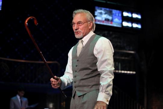 Shylock (Patrick Stewart) holding a walking stick.