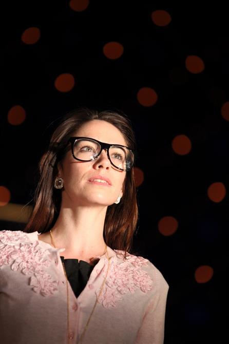 Production image of Jessica (Caroline Martin) in glasses.