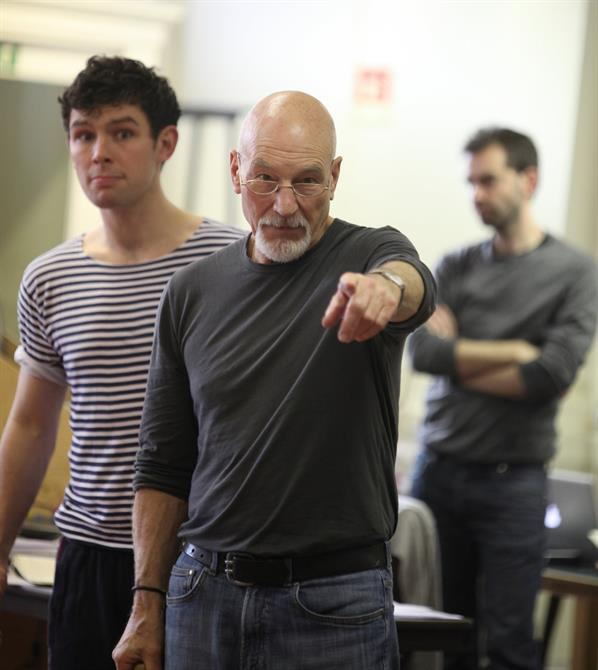 Shylock (Patrick Stewart) points a finger towards the camera.