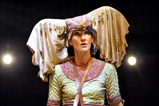 Carla Mendonça as Elephant, with a cream coloured headdress representing the elephant's ears
