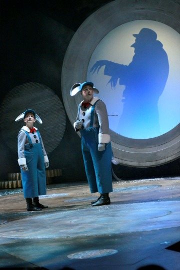 Bettrys Jones as Child and Daniel Ryan as Mouse stand in front of a silhouette of a creepy man with pointed claws and nose