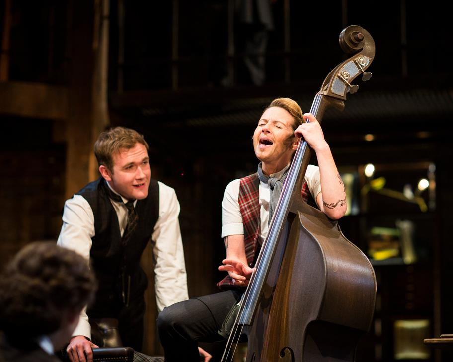 Lisa Dillon as Moll, playing a double bass and singing