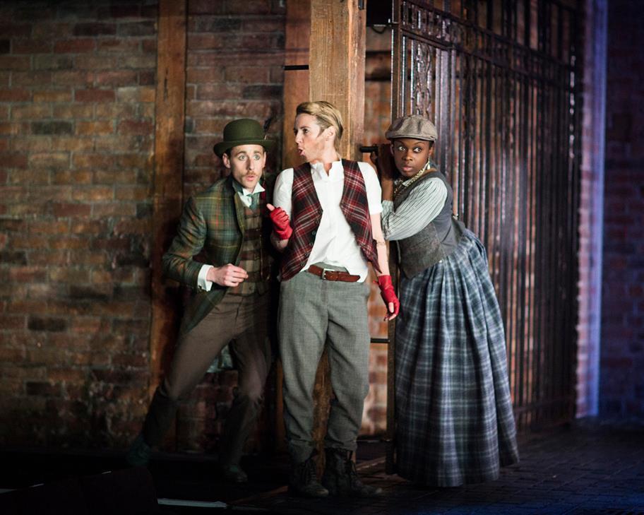 Jack Dapper, Moll Cutpurse and Annie in The Roaring Girl leaning against a brick wall