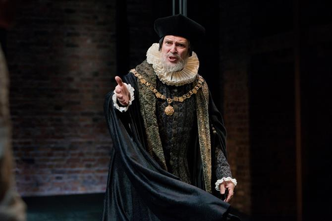 Production image of William Gaminara as Sir Roger Oatley.