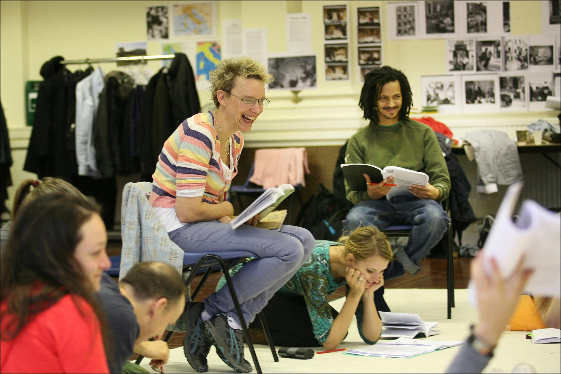 Women in stripey top laughs as she sits directing actors in rehearsals for The Taming of the Shrew 2012