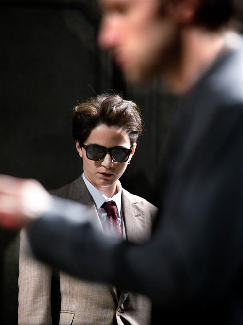 Pearl Chanda as Julia, dressed up in a suit and sunglasses as a man