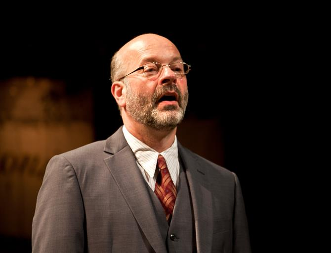 Keith Osborn as Antonio, a mostly bald man with glasses