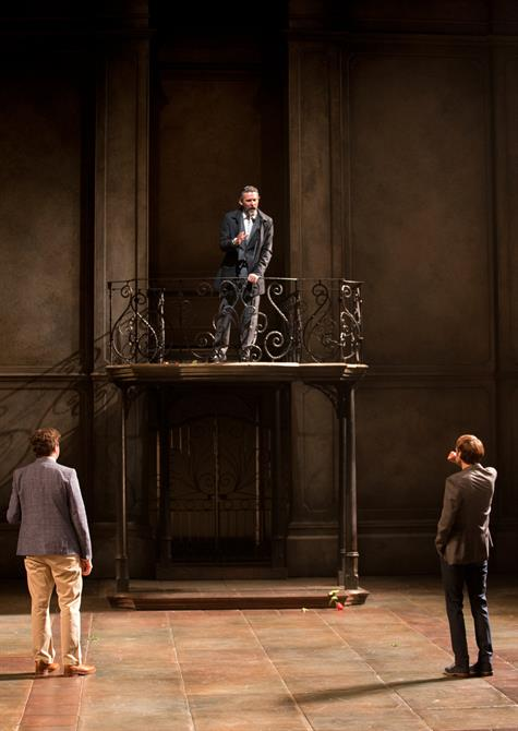 Turio and Proteus look up at the balcony, where the Duke of Milan stands and talks
