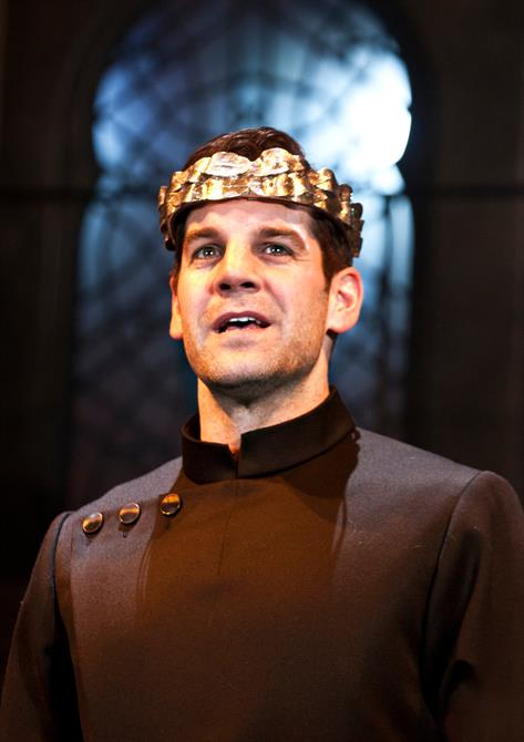 Production image of John Hopkins as Saturninus, wearing a crown.