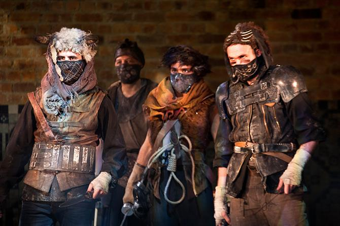 Production image of Titus Andronicus cast members.