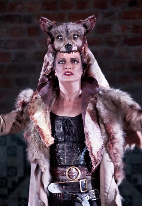 Katy Stephens as Tamora with faux Wolf skin outfit.
